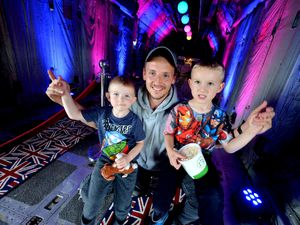 Freddie (five), Harry (three), and Jamie McMulkin from Walsall, in the Popcorn Bar inside a Hercules plane