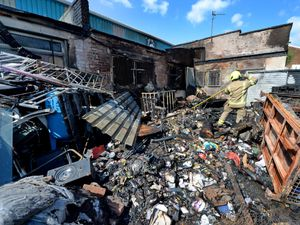 The charred remains after a fire at the rear of M.W. Interiors in Willenhall