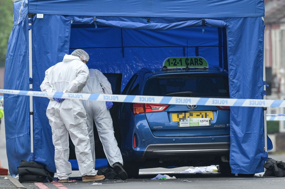 A forensics tent was put up over a taxi from 121 Cars, based in Tipton. Photo: SnapperSK.