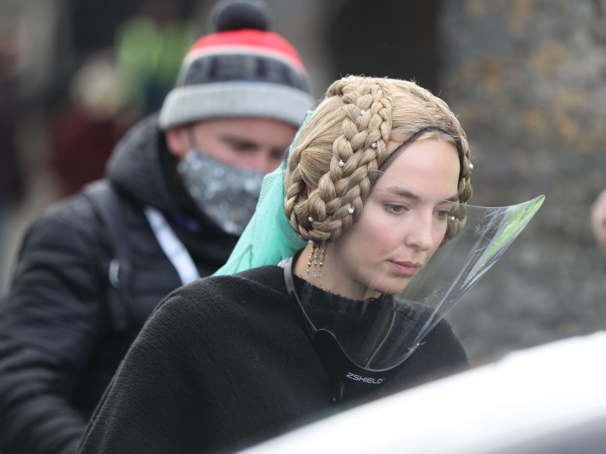 Jodie Comer wears a face shield on the set of film The Last Duel