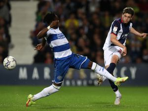 WEST BROMWICH, ENGLAND - SEPTEMBER 25: .Moses Odubajo of Queens Park Rangers and Adam Reach of West Bromwich Albion during the Sky Bet Championship match between West Bromwich Albion and Queens Park Rangers at The Hawthorns on September 25, 2021 in West Bromwich, England. (Photo by Adam Fradgley/West Bromwich Albion FC via Getty Images).