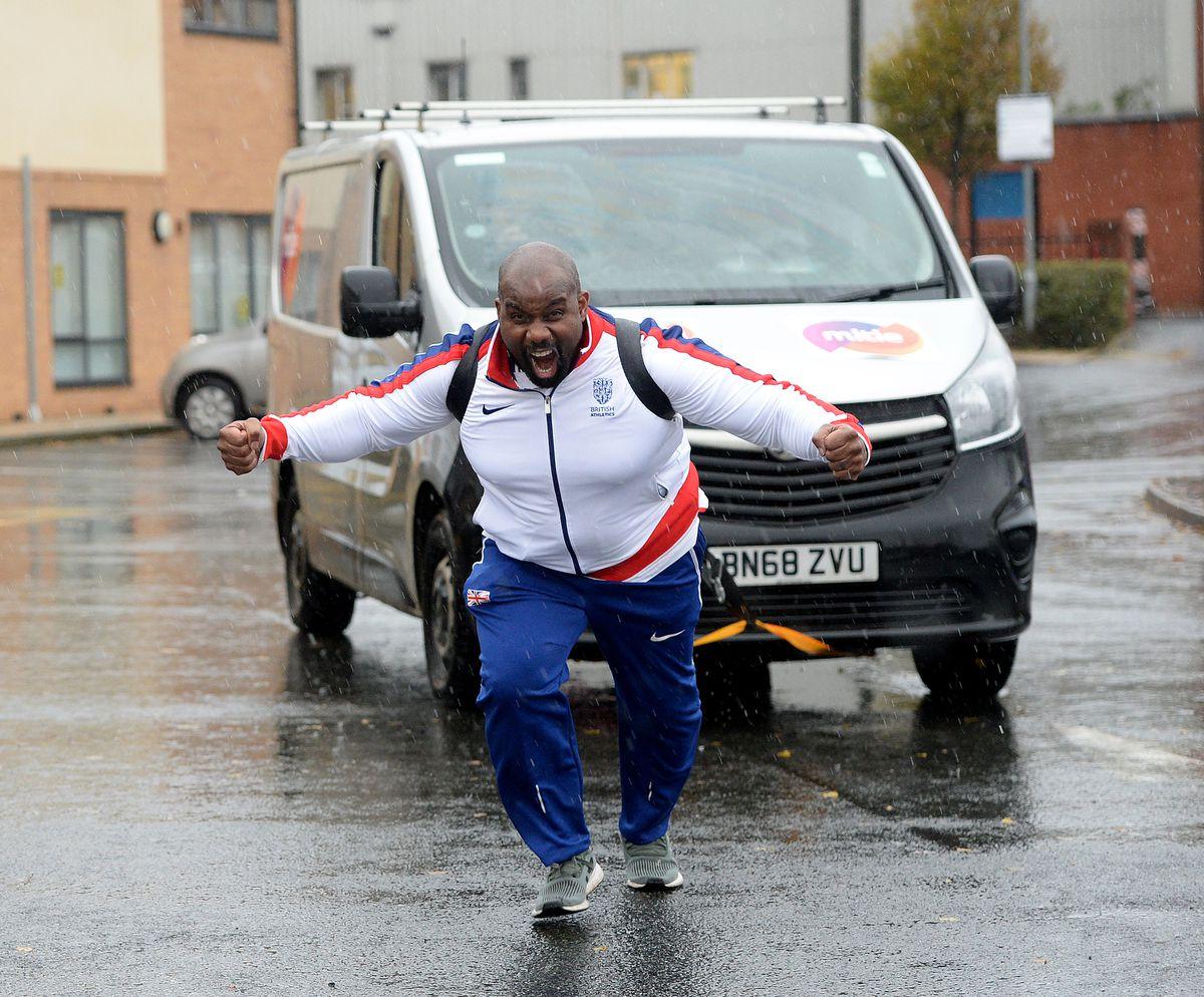 Kevin Brown pulls a van across the car park
