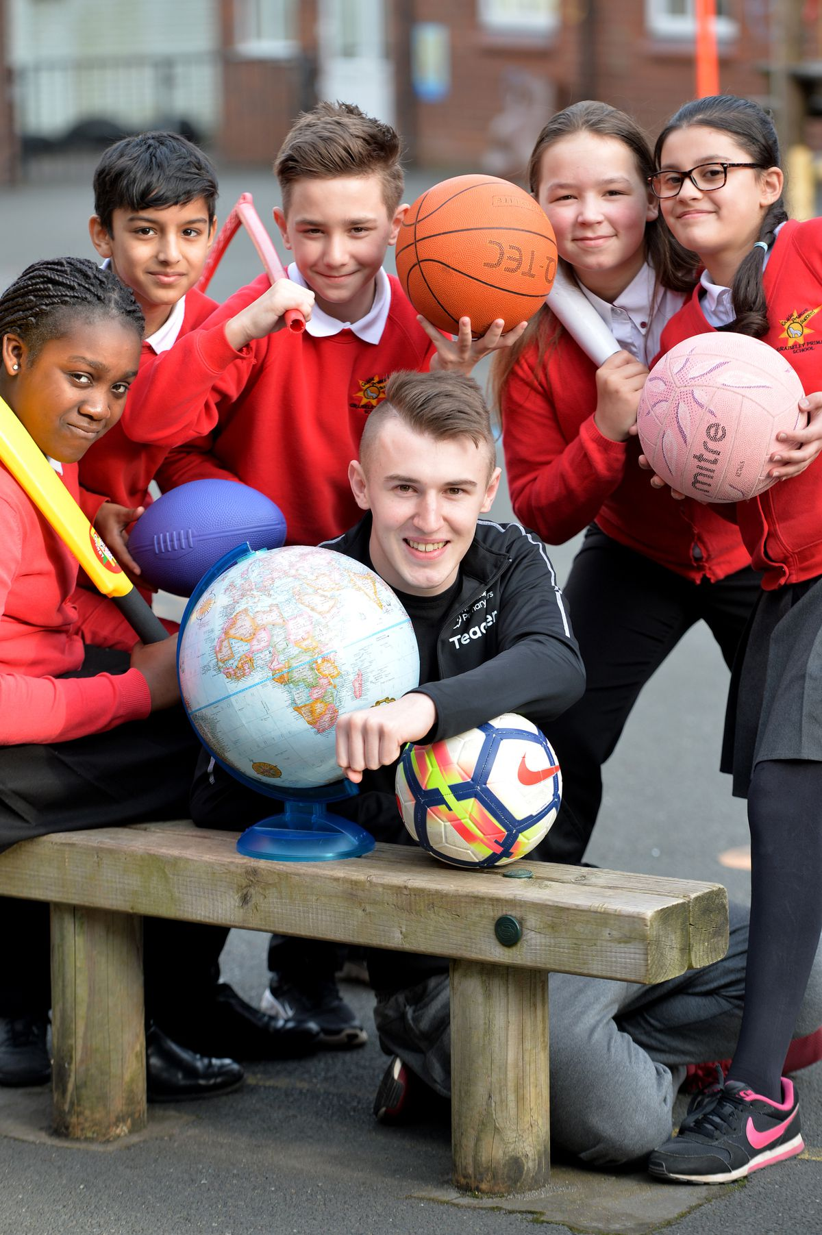 WOLVERHAMPTON COPYRIGHT TIM STURGESS EXPRESS AND STAR...... 05/02/2020.....  Jordan Clarke(front centre) an apprentice PE teacher at Graisley School is fundraising to go to Africa this year. He previously set up a charity to do small acts of kindness. Pictured with year 6 students...