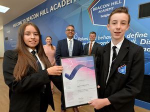 DUDLEY  COPYRIGHT TIM STURGESS EXPRESS AND STAR...... 23/06/2021 Beacon Hill Academy, Dudley , has been presented with a national award for its quality of teaching during lockdown. Pictured ,  Left, Aaliyah Lewis, Anneka Johnson, Sukhjot Dhami, headteacher, Karl Quiney and Kai Marsh...