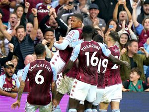 Aston Villa players celebrate in front of the fans