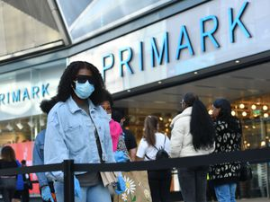 Customers outside a Primark store