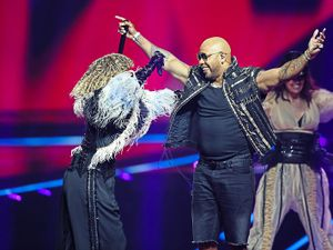Senhit, left, from San Marino embraces rapper Flo Rida at the second semi-final of the Eurovision Song Contest at Ahoy arena in Rotterdam. Photo: AP Photo/Peter Dejong