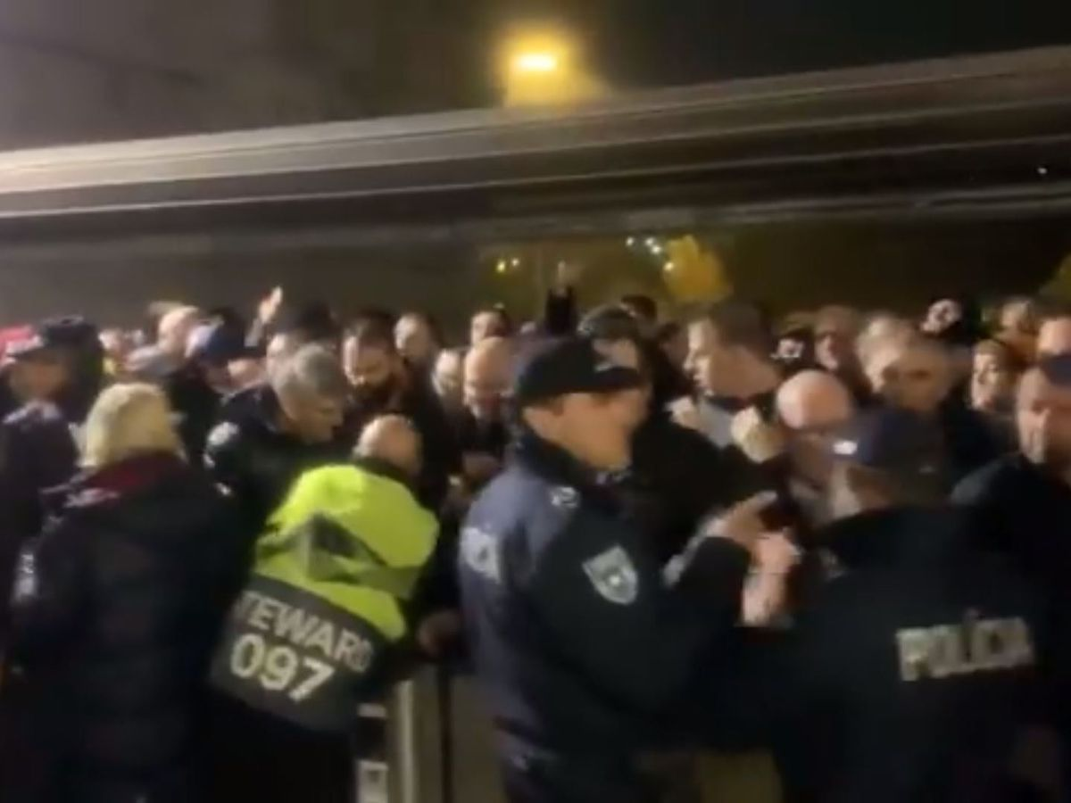 Fans pushed up against the turnstiles in Braga. Photo: Lee Tompson