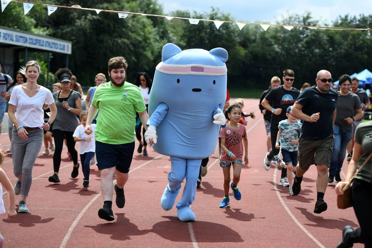 Buddy the mascot goes on a run at Wyndley. Pictures: Richard Harris