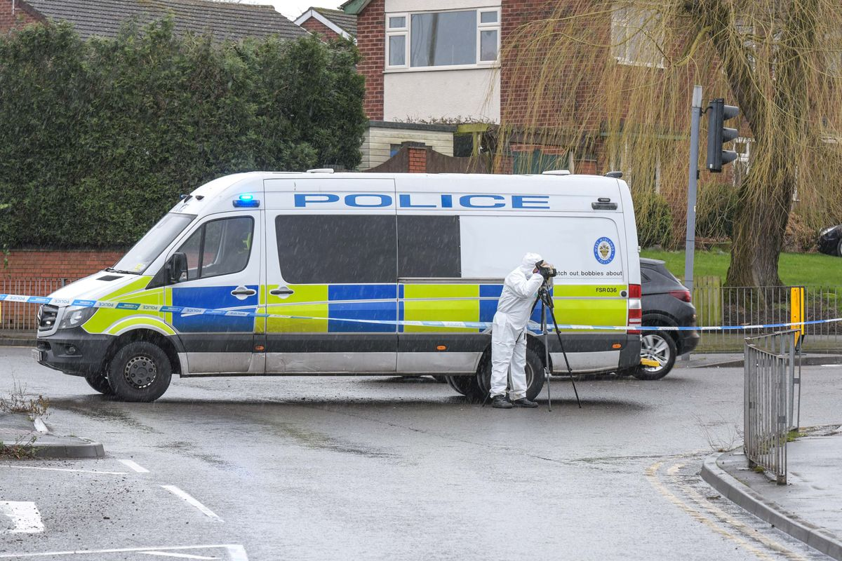 Police at the scene off Pensnett Road. Photo: SnapperSK