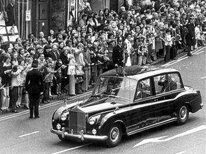 The Queen and Duke of Edinburgh's Rolls-Royce was pictured sweeping through the streets of Wolverhampton during their Silver Jubilee tour of the West Midlands in 1977. The car broke down at Walsall and mechanics Chris Tate and Fred Budd were called to repair it