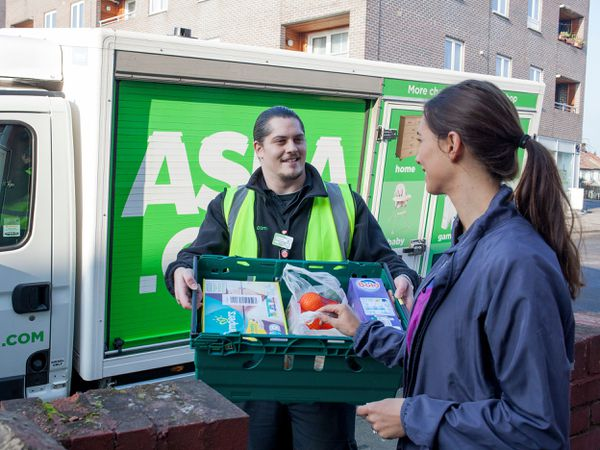 An Asda driver makes a delivery