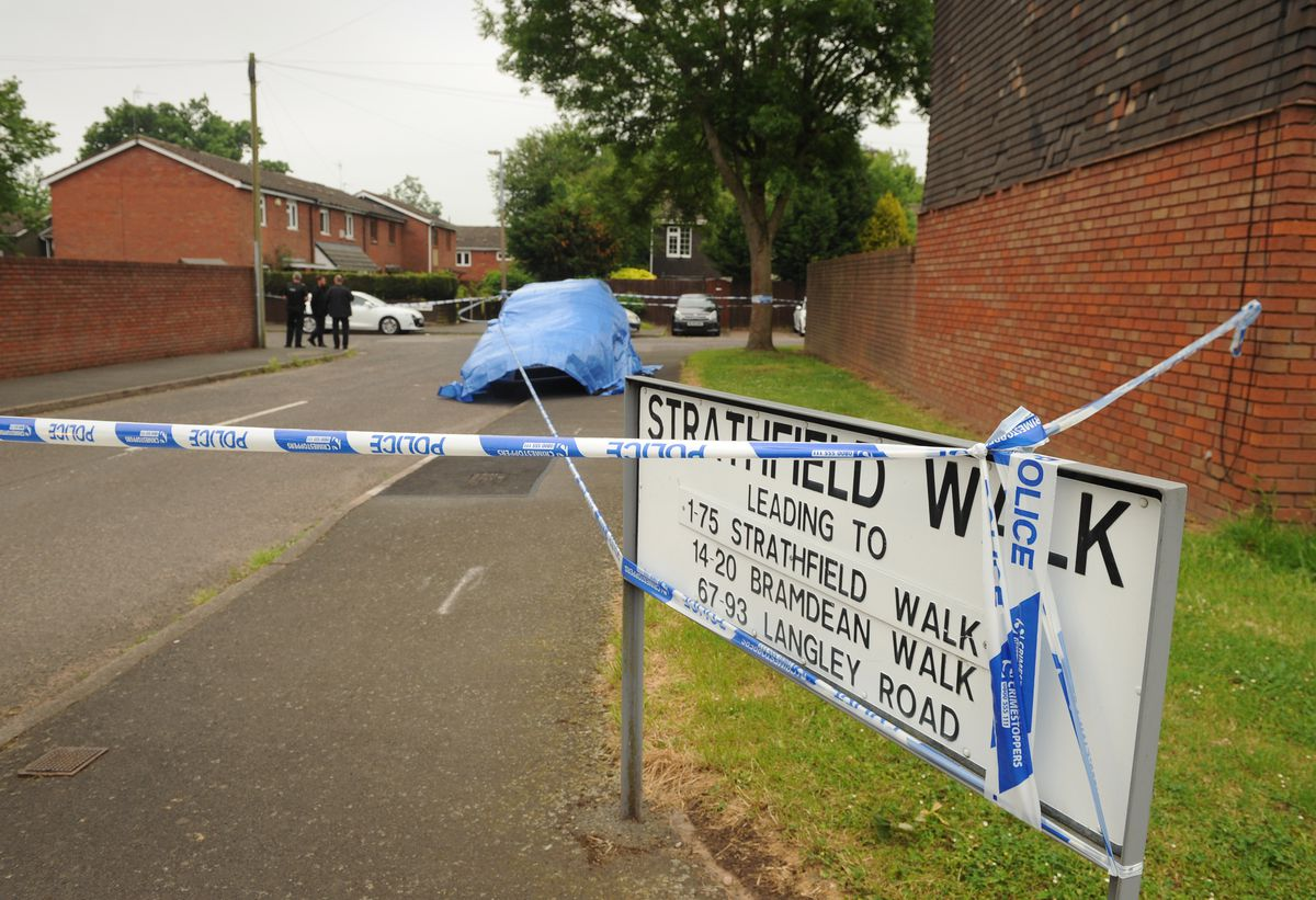Police tape across the entrance to Strathfield Walk in Merry Hill