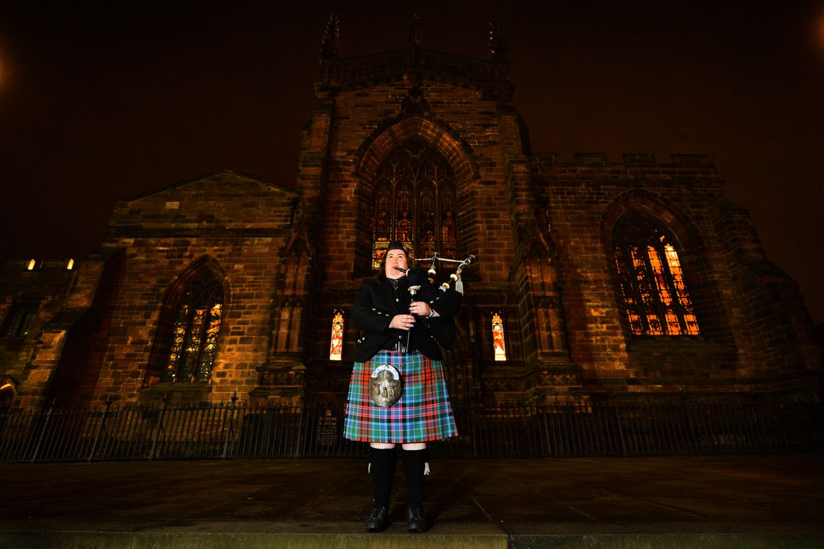 A lone piper, Vicki Kennerley from the Wolverhampton Pipe band played a lament on the steps of St Peter's Church, in Wolverhampton