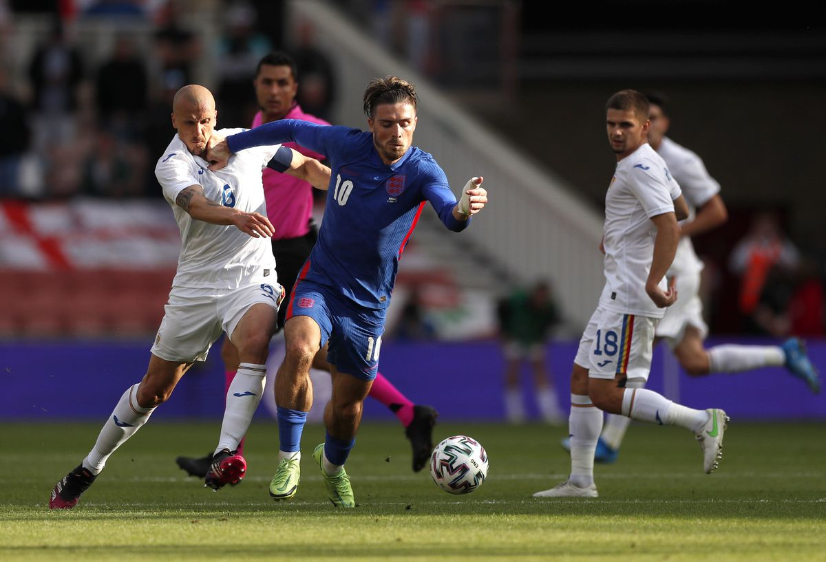 Romania's Vlad Chiriches (left) and England's Jack Grealish battle for the ball.