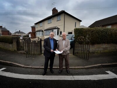 Stop fining us! Distraught elderly couple slapped with parking tickets outside their own home