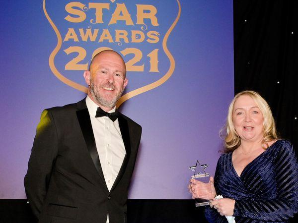 Chief executive Richard Beeken with winner Julie Booth