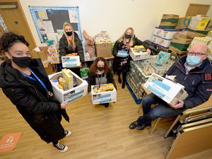 Members of the schools being helped by Excel Church show off the food parcels they take away each week. Pictured with Pastor Dek Dudfield (right) are Hayley Holder from Lanesfield Primary School, Stephanie Wootton from Bilston CE Primary School, Nicolina Alaimo from Field View Primary School, and Jodie Paskin from Loxdale Primary School