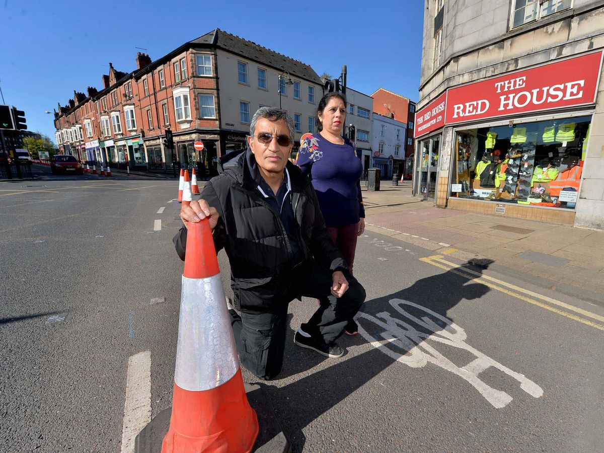 Gurdeep and Harjeet Gill outside The Red House. Mr Gill said he wasn't happy about the cycle lanes because of the issues it was causing customers