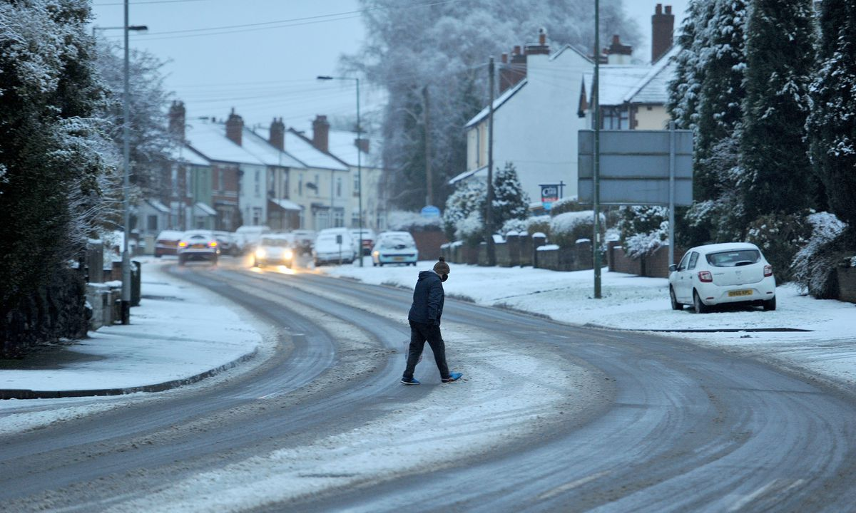 A pedestrian negotiates the road in Rushall