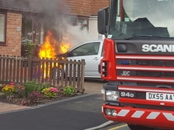 Car bursts into flames on driveway