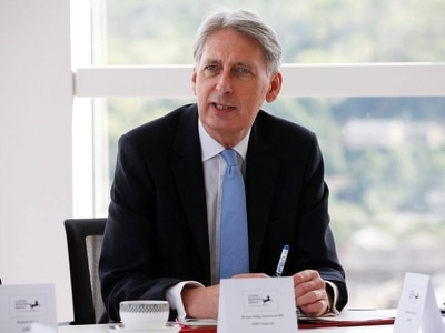 Philip Hammond boosted as borrowing revised downwards