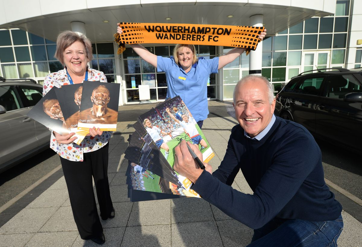 Wolves legend Steve Bull, who is signing pictures which will be auctioned off to raise money at Russells Hall Hospital. He is pictured with Karen Kelly, chief operating officer and sister Gayle Smith, who is a big Wolves fan