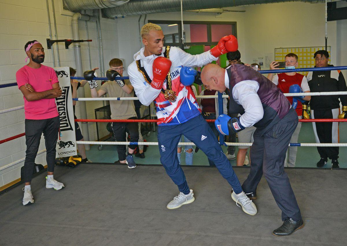 Olympic boxer Ben Whittaker visits The Way Youth Zone in Wolverhampton where he took on mayor Greg Brackenridge.