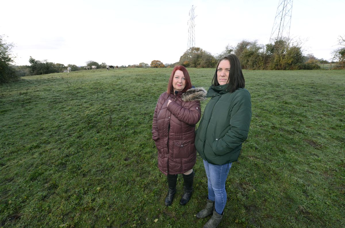 Jayne Marsh, left and Shelley Hallam, standing on the site next to The Straits which is earmarked for new homes