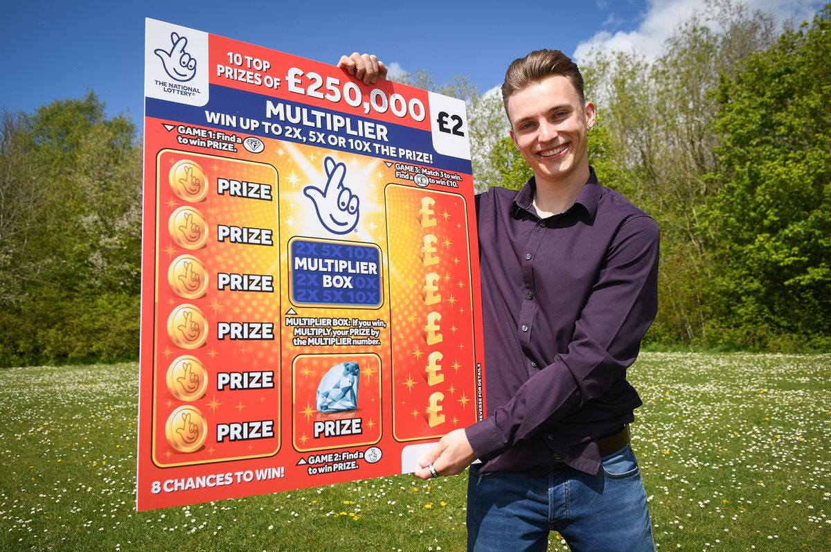 Luke Ashman is celebrating after his scratchcard win