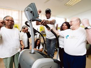 Former Goodyear workers hand of a Stair Master for the Fordhouses Health and Fitness Group as part of the benevolent fund