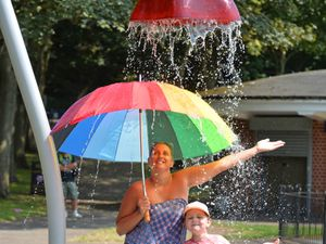 Cooling down in the splash pads, at Walsall Arbretum, Becky Snaiph and her niece Isabelle Elgerton, aged 8, both of Wolverhampton