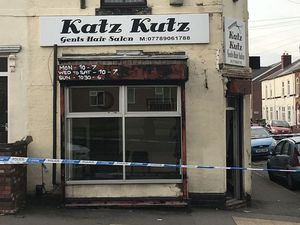 A police cordon at the scene of a shooting at Katz Kuts barbershop on Wolverhampton Road in Walsall on May 19, 2019.