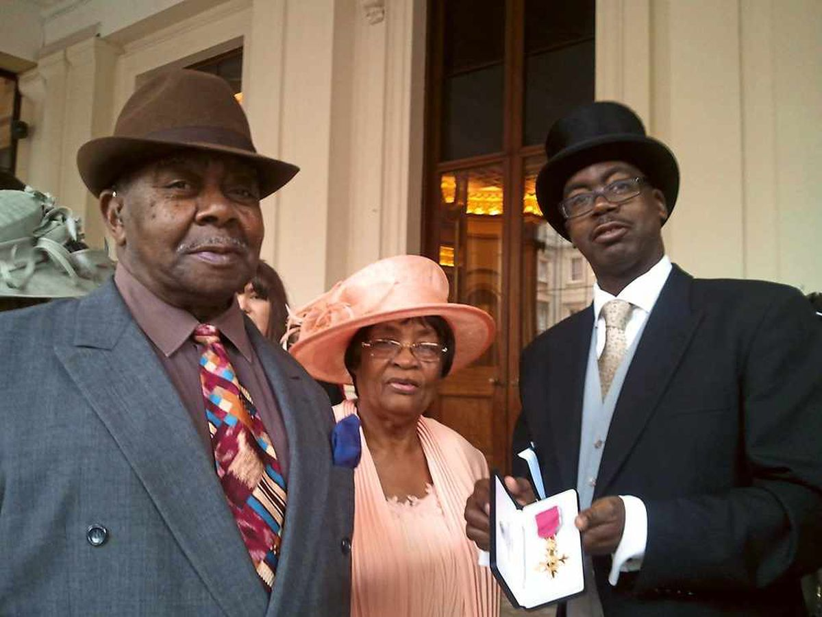 Patrick Vernon with his parents and OBE medal