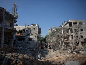 Palestinians inspect their destroyed houses following overnight Israeli air strikes in town of Beit Hanoun, northern Gaza