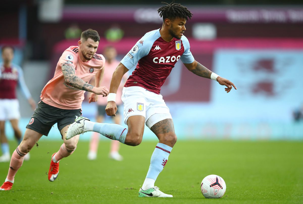 Sheffield United's Oliver Burke (left) and Aston Villa's Tyrone Mings in action