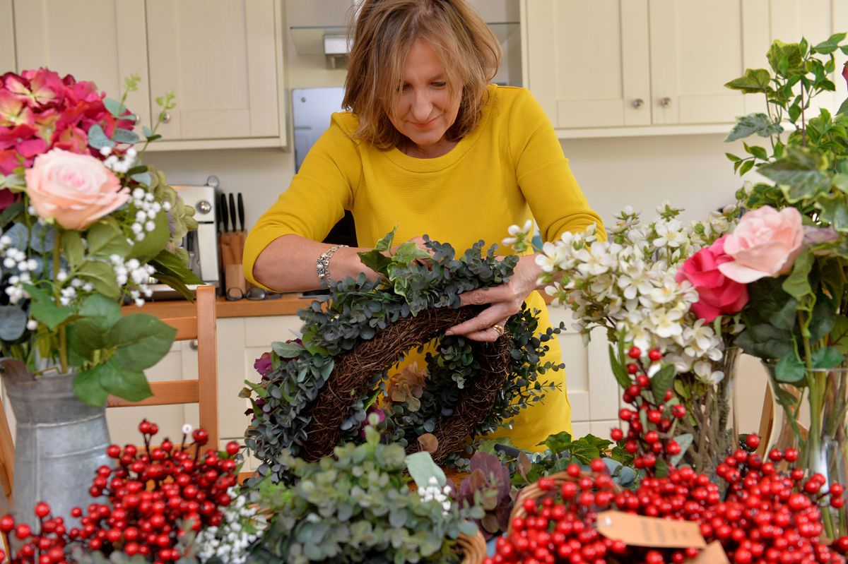 Each wreath is created on a willow base, followed with a generous bed of foliage before each individually selected flower is added