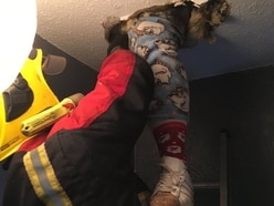 Woman falls through ceiling getting Christmas decorations out of the attic