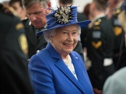 Glitter balls, a dog bed and a Union Jack from a spacesuit among Queen's gifts