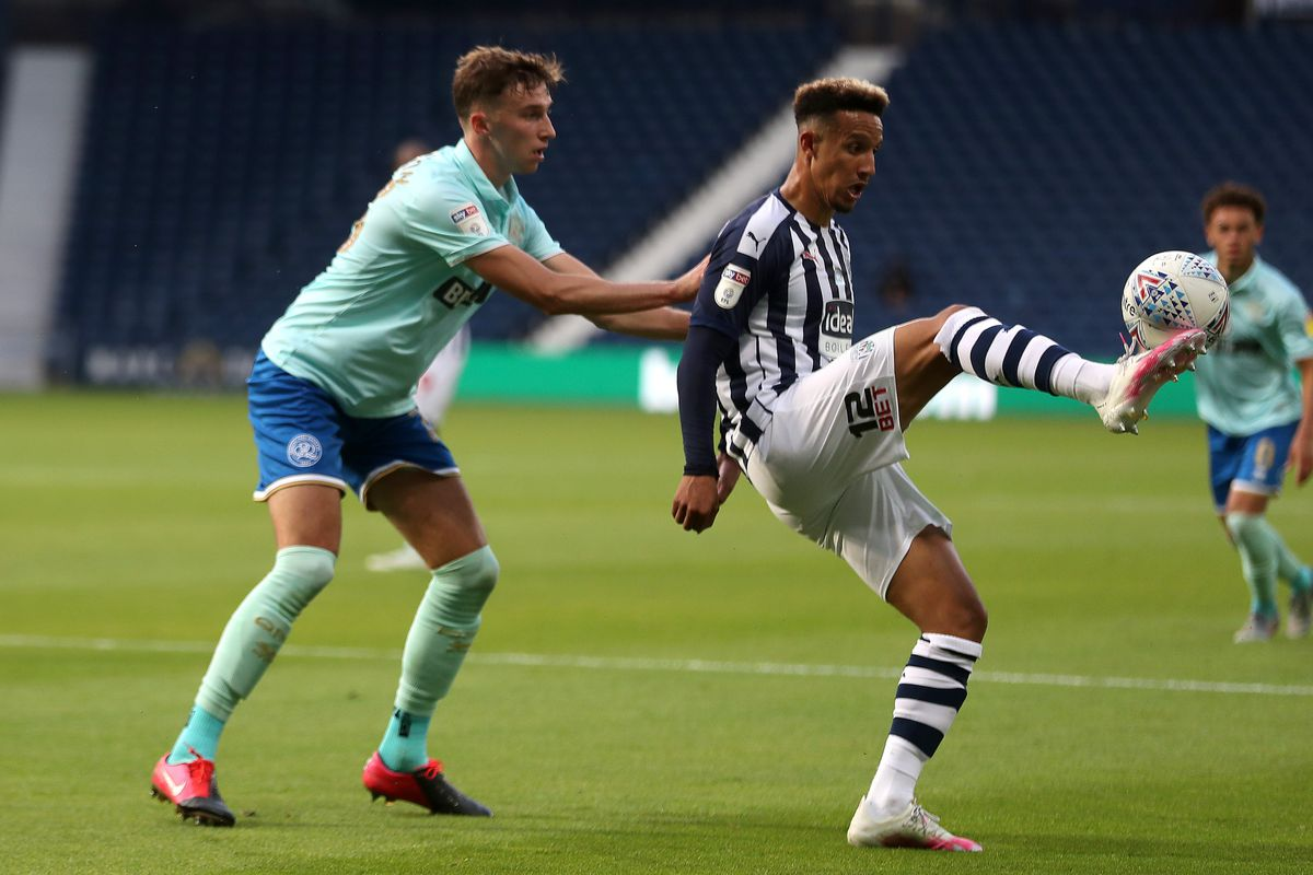 Conor Masterson of Queens Park Rangers and Callum Robinson of West Bromwich Albion. (AMA)
