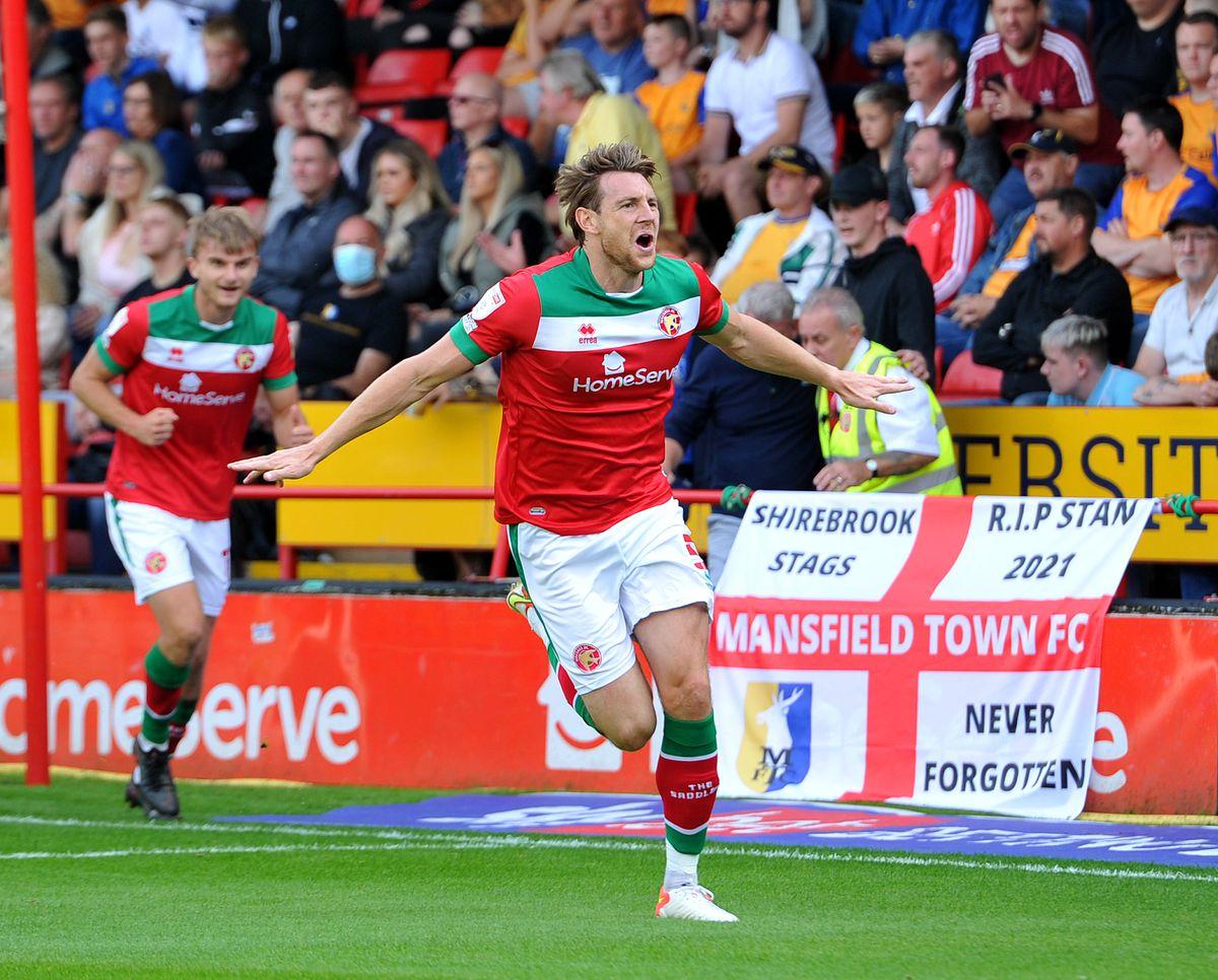 Ash Taylor celebrates his goal..