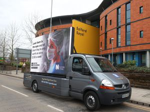 Digital ad board outside the Salford Royal Hospital, Manchester, by the Royal College of Nursing in response to the Government's NHS pay proposal