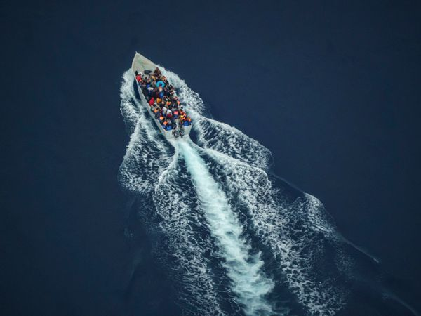 Migrants on small boat