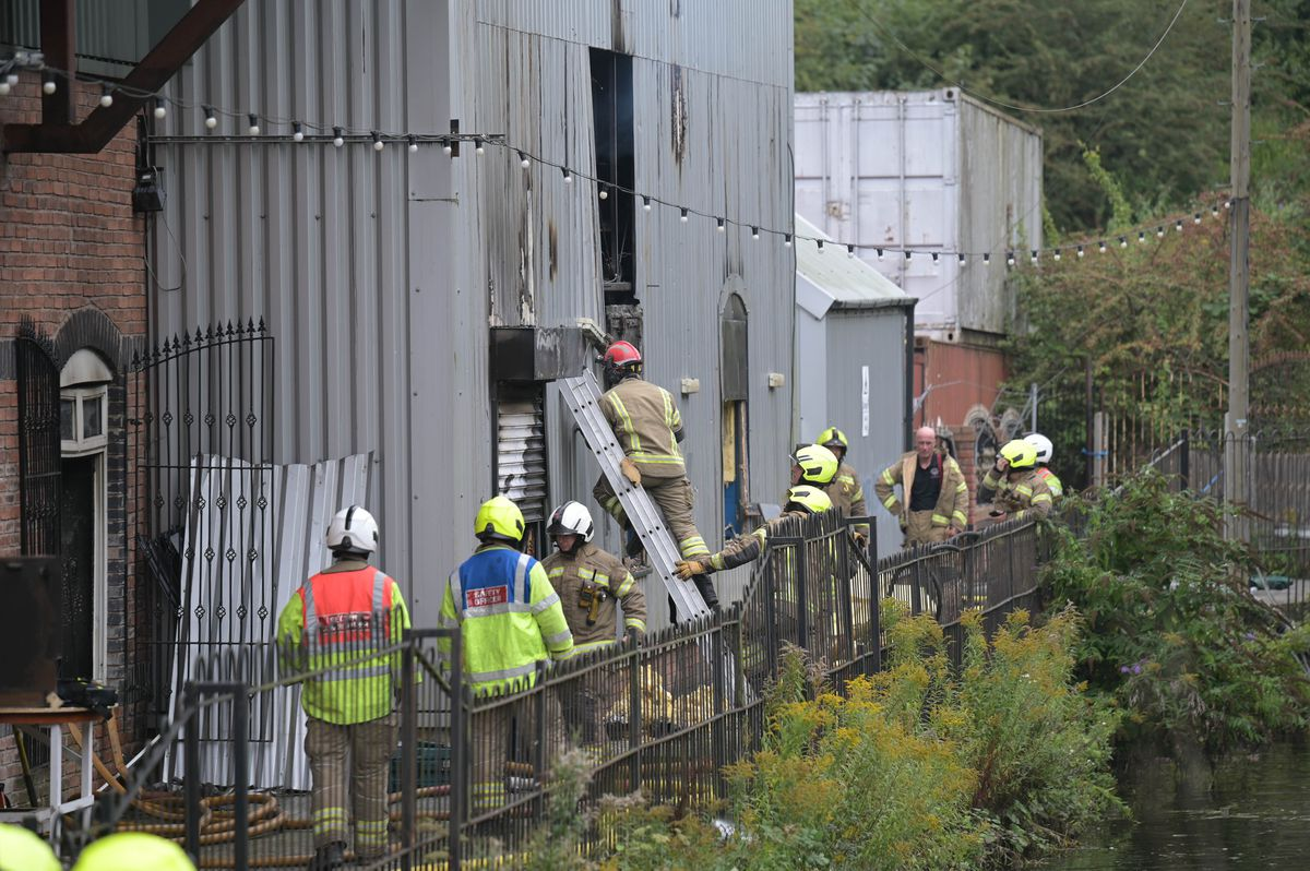 Firefighters look into the building off Fox's Lane. Photo: SnapperSK