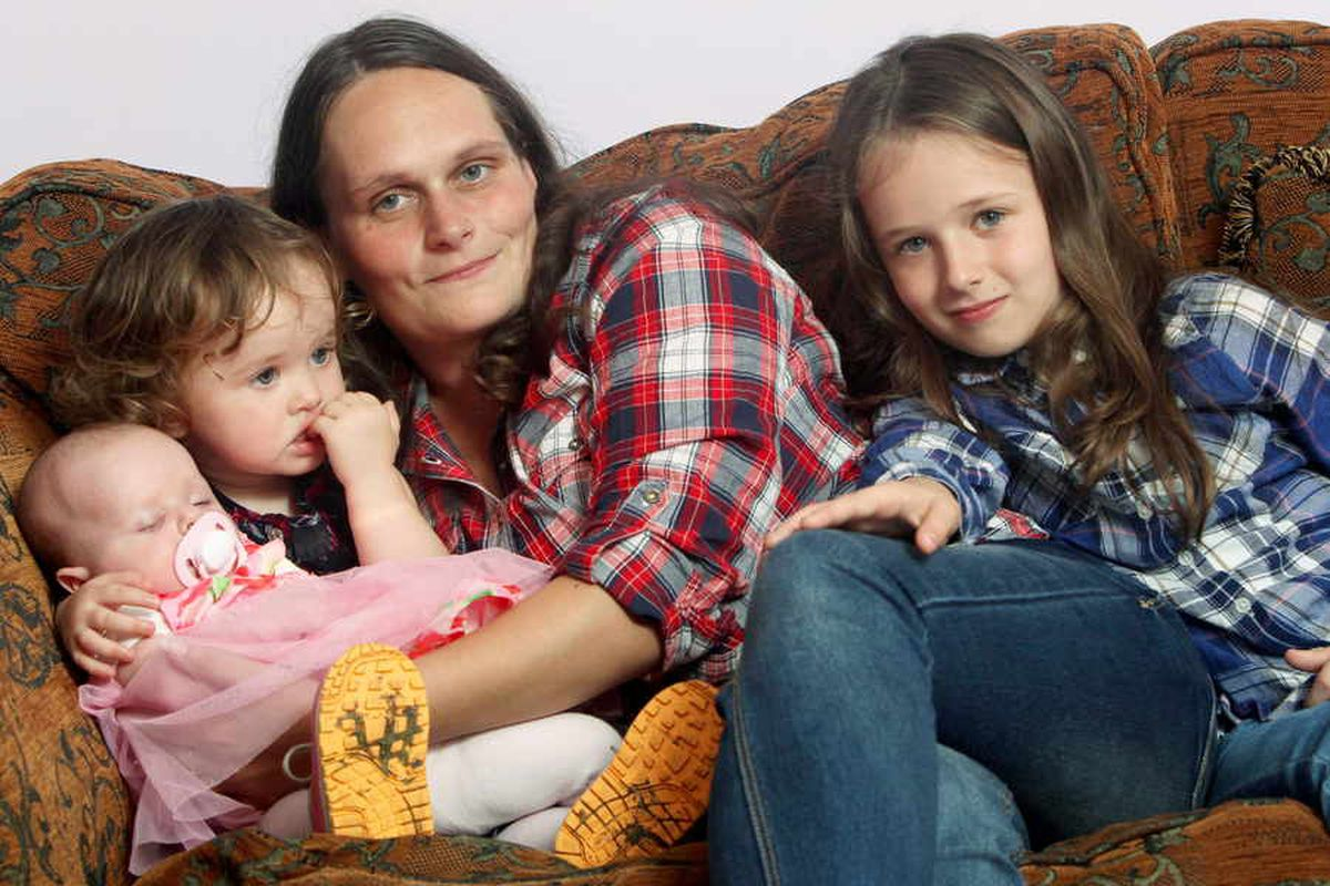 Nine-year-old girl hailed Britain's youngest midwife after she delivers both baby sisters