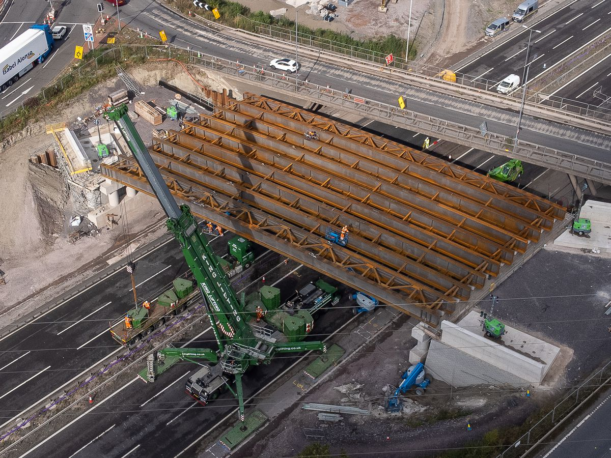 A large crane was used to lower the beams into place. Photo: Paul Turner