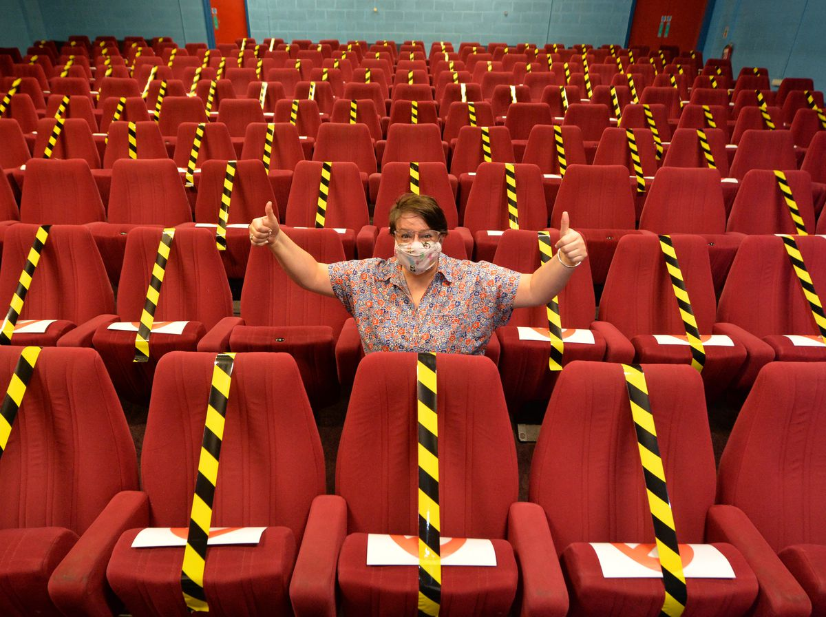CEO Kelly Jeffs celebrates as the Light House Cinema in Wolverhampton reopens