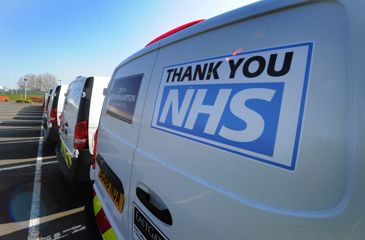 """Vans are adorned with messages on back doors saying """"Thank You NHS"""""""