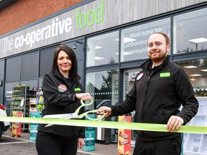 Store manager Lindsey Kearney, left, and team leader Shaun Miller cut the ribbon on the relaunched Curborough Road Central England Co-op