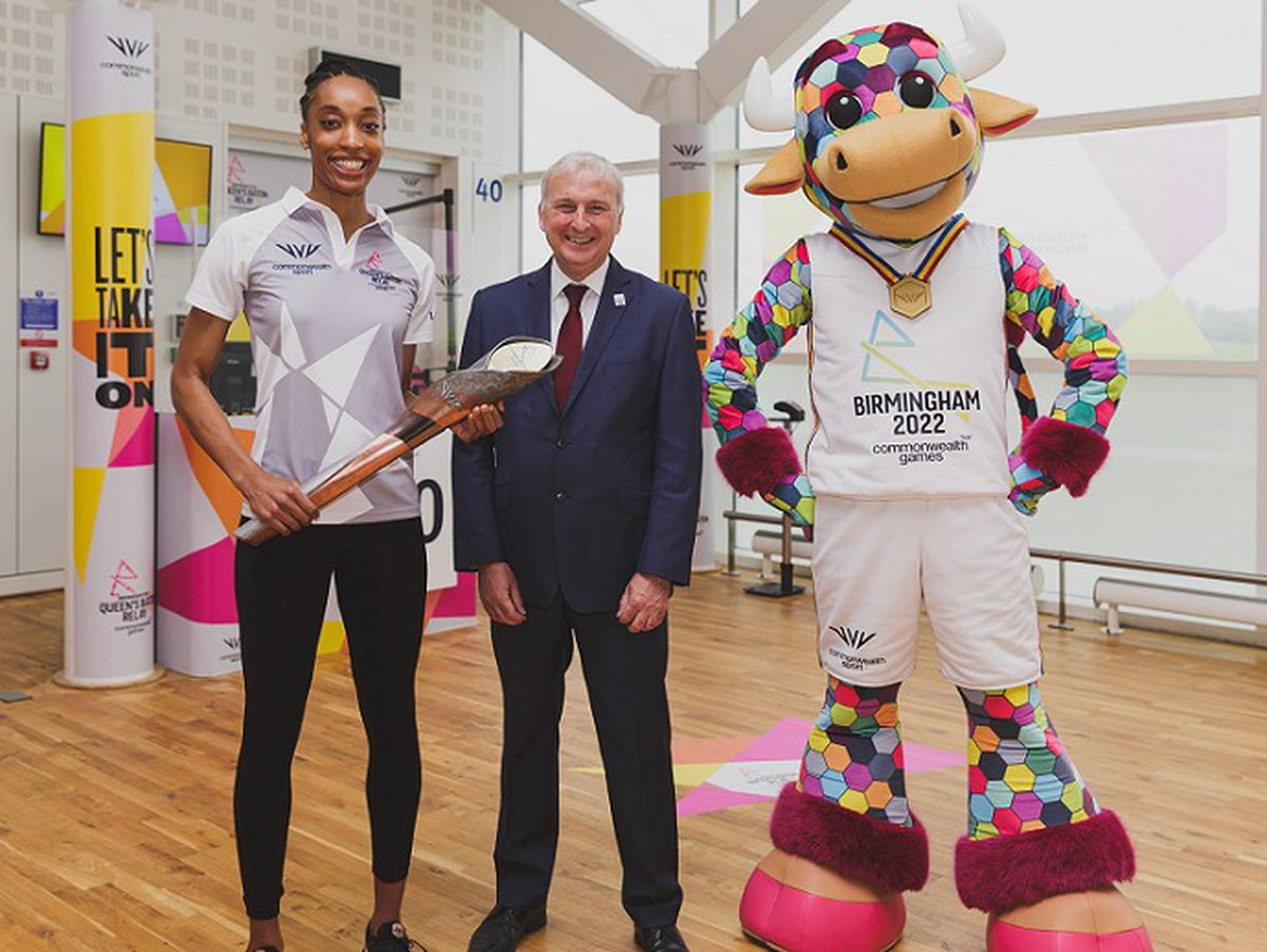 Team England netball player Layla Guscoth and Cllr Ian Ward, Leader of Birmingham City Council with the baton at Birmingham Airport